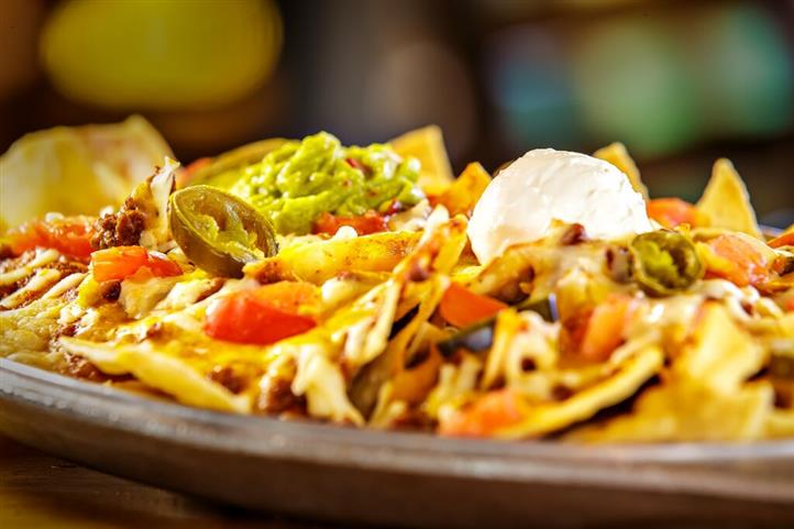 loaded nachos with sour cream and jalapenos
