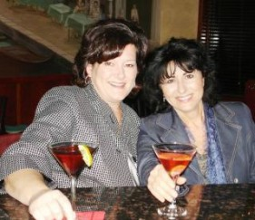 two females holding martinis
