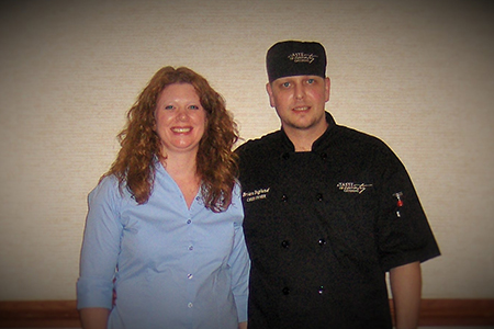 Woman and man chef posing for picture