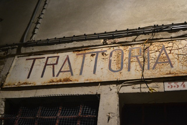 sign that reads trattoria