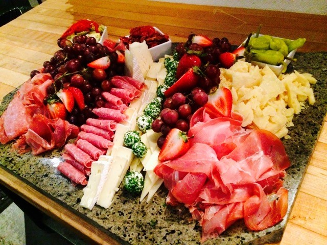 tray with various meat, cheese and fruit