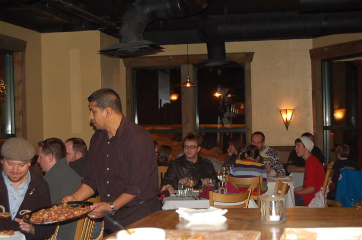 customers being served by waiter inside restaurant