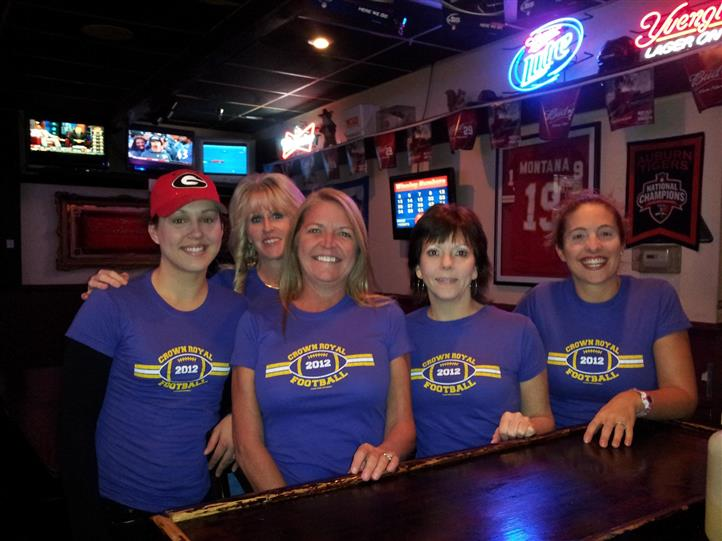 "5 women with matching ""Crown Royal Football 2012"" shirts"