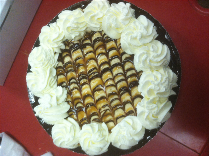 a pie with chocolate and whippedcream topping