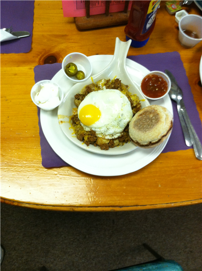 eggs on hash brown with various sides