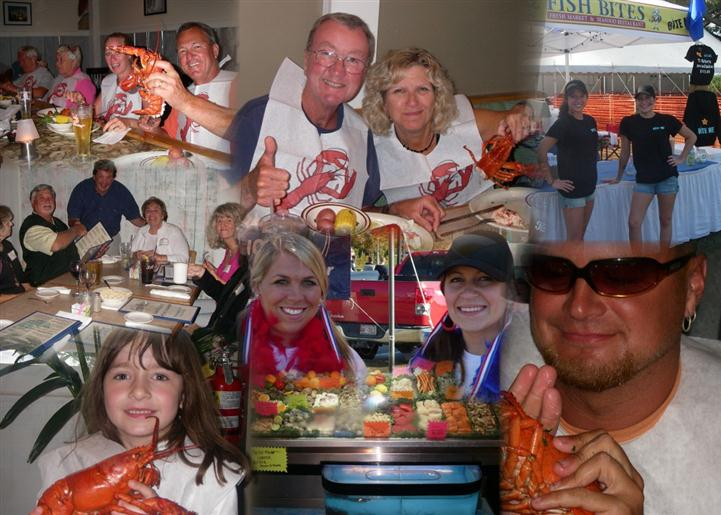 An assortment of customers holding up cooked lobsters and smiling for the camera