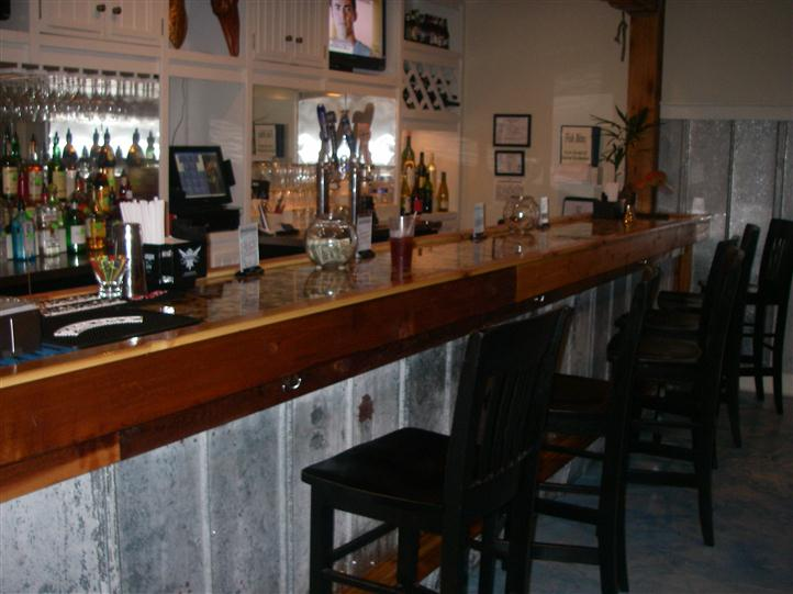 THe bar counter in the restaurant with bar stools