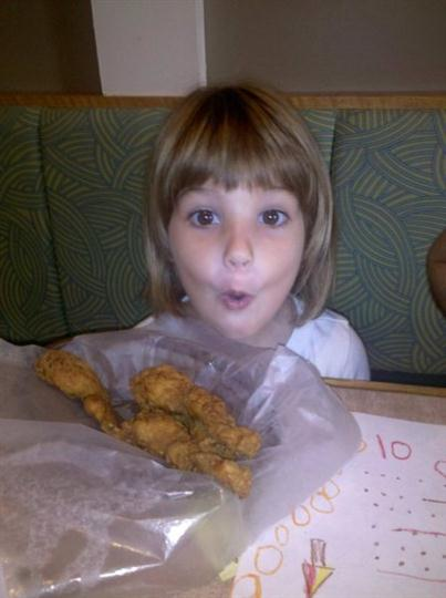 a kid in front of her menu item