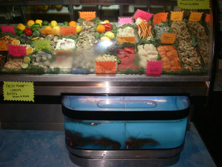 The fresh fish counter with live lobsters in front