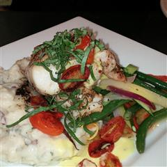 Menu items with mashed potatoes, green beans and tomatoes