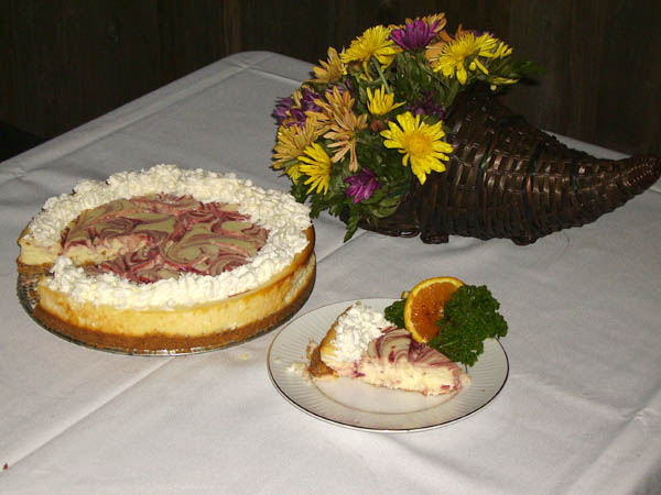 Pie beside a vase with flowers