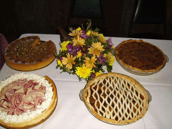 Pies beside a vase with flowers