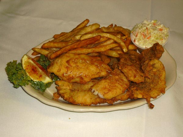 Fried fish with a side of french fries and coleslaw