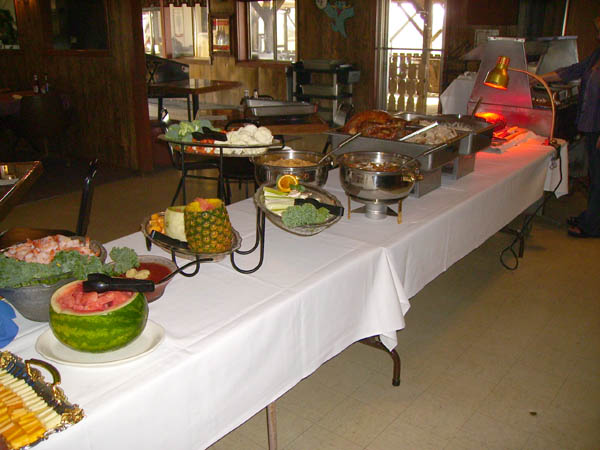 Catering table with stoves and fruits