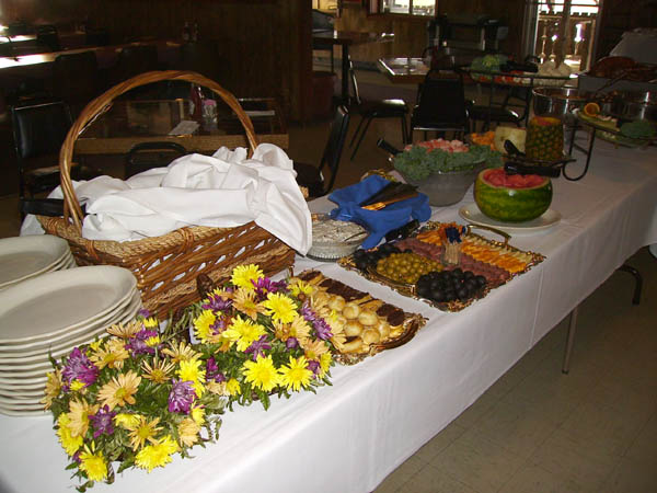Catering table with flowers and fruits