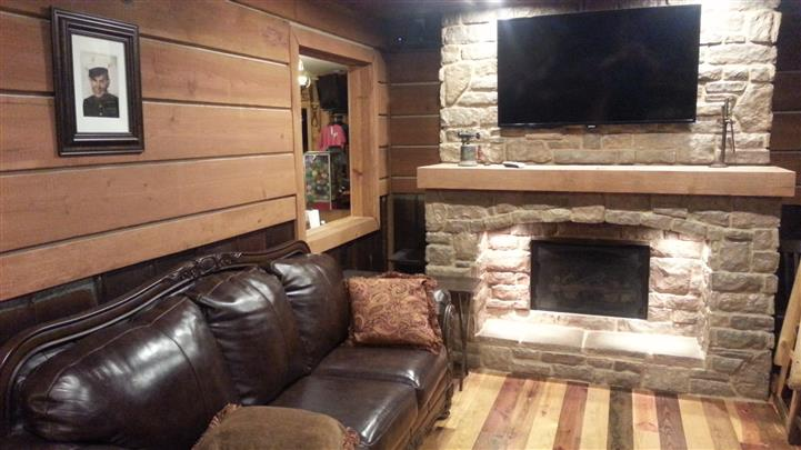 a couch by a fireplace