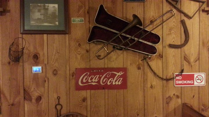 coca cola sign and an instrument on the wall