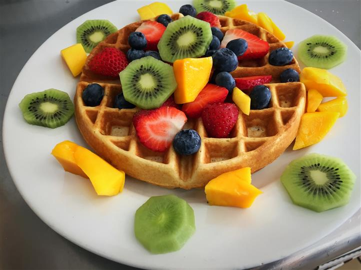 waffle topped with various fruit