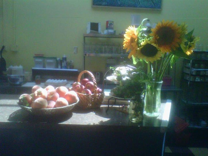 Counter with fruits and sunflowers