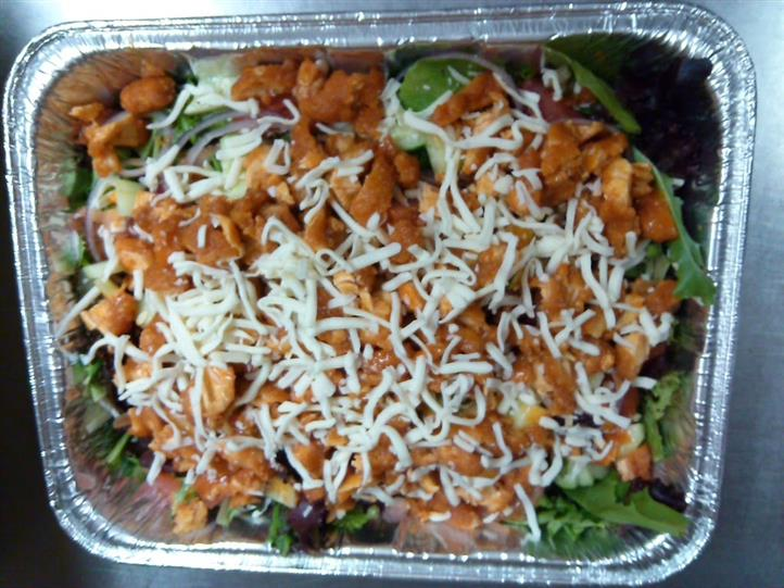 Fresh veggies salad topped with chicken and shredded cheese