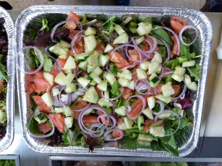 Fresh veggies salad with cucumber, lettuce, onions, tomatoes