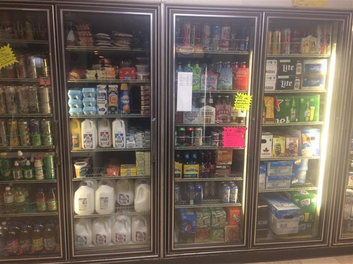 A market fridge with various products
