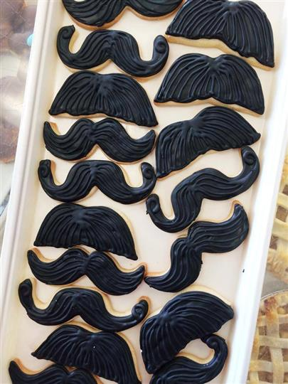decorated cookies shaped like mustaches