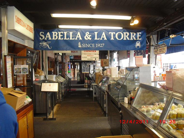 Sabella & La Torre since 1927 banner hanging over kitchen area