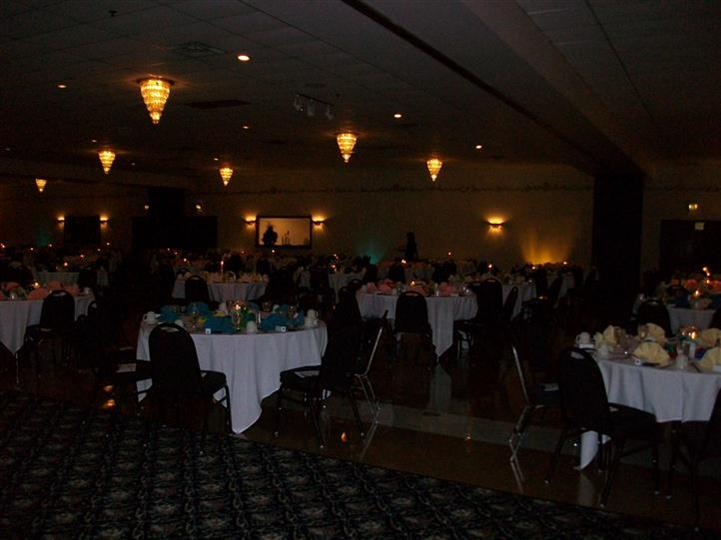 Catering hall setup with multiple chairs and tables