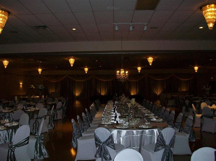 Tables and chairs setup for an event with ribbons
