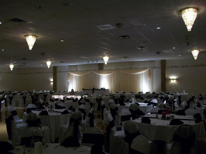 Tables set up for an event with lights