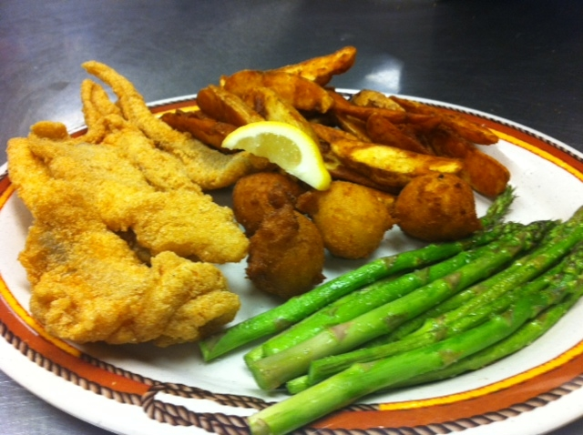 Asparagus served with Fried fish, Hush puppies, and potato wedges