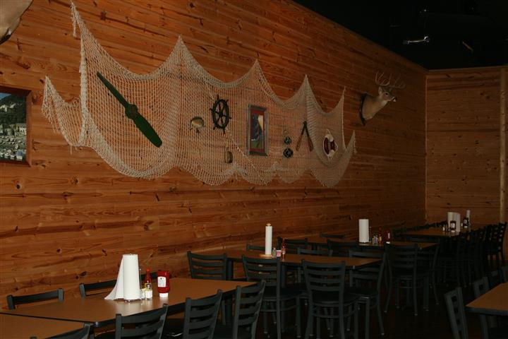 Dining area with decorations on the wall