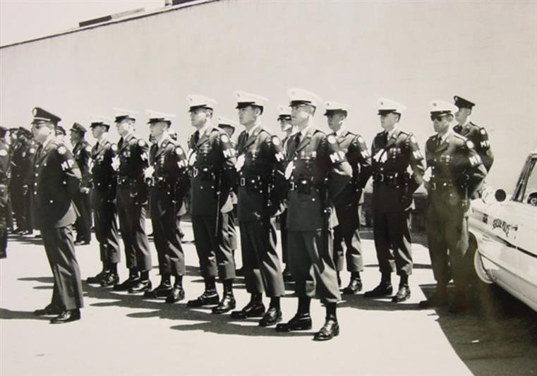 Police officers standing at attention
