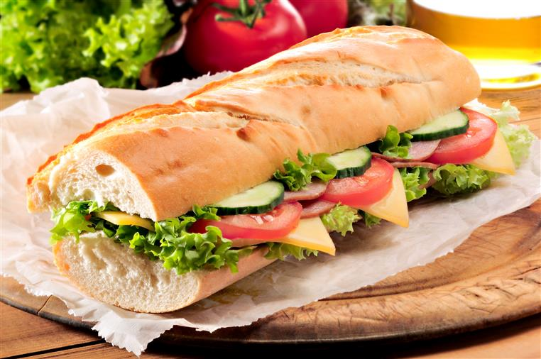 sub with lettuce, tomato, cucumber, cheese