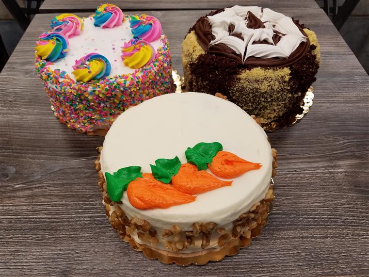 mni cakes with various frostings and decorations