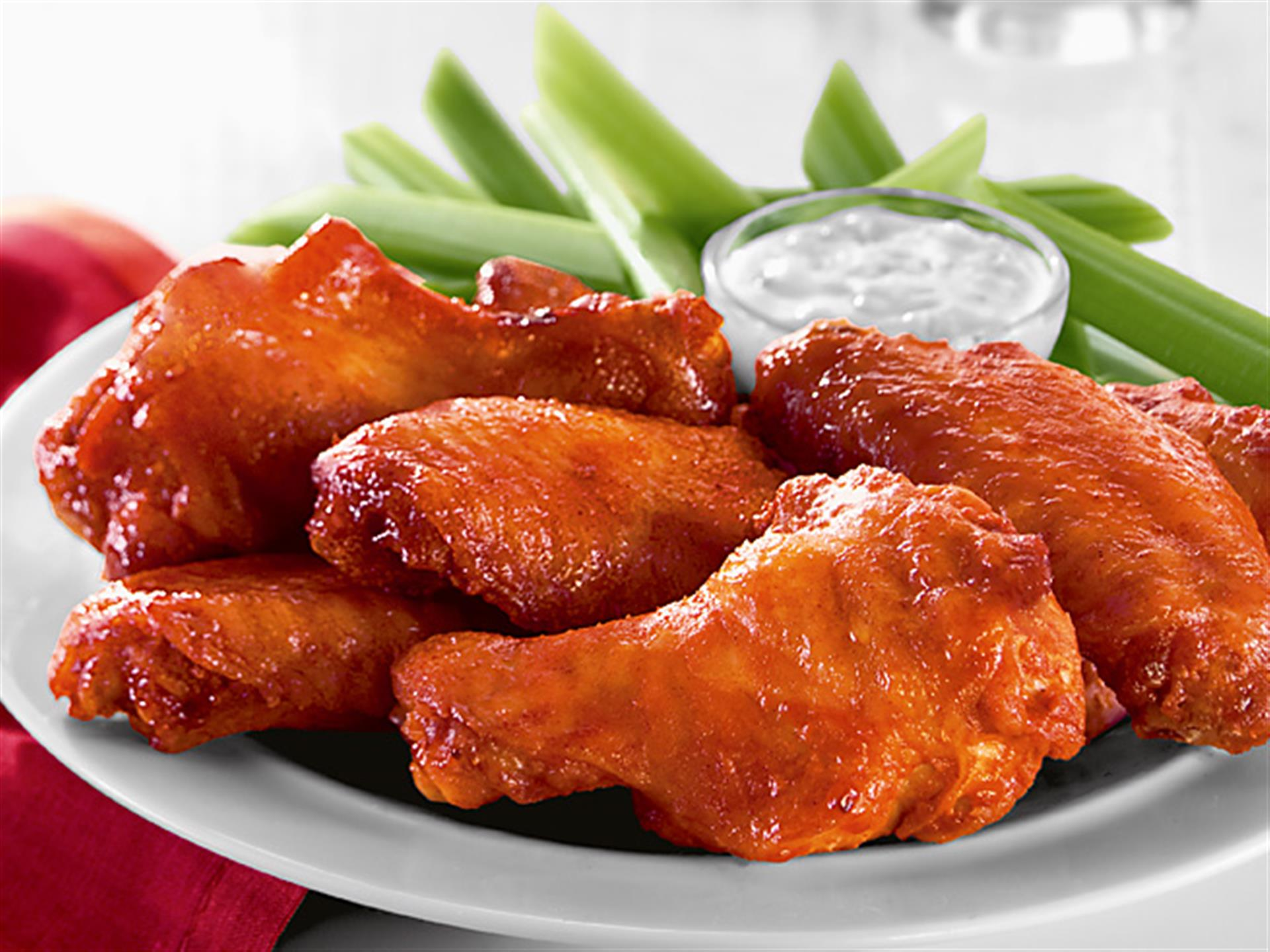 buffalo chicken wings with celery and dipping sauce