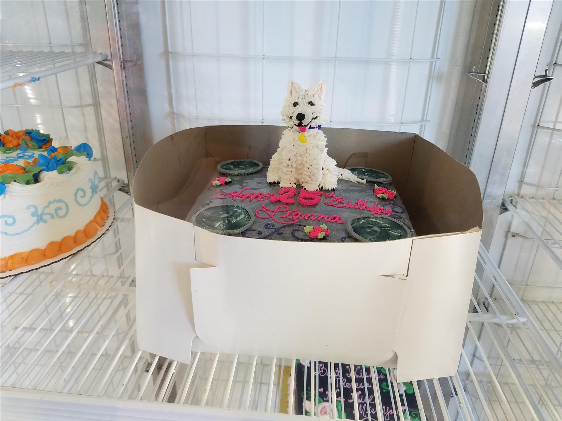 cake with a white dog created on top