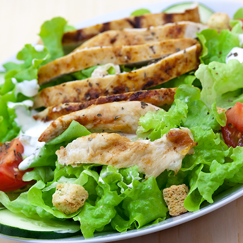 Salad with grilled chicken, tomatoes, croutons