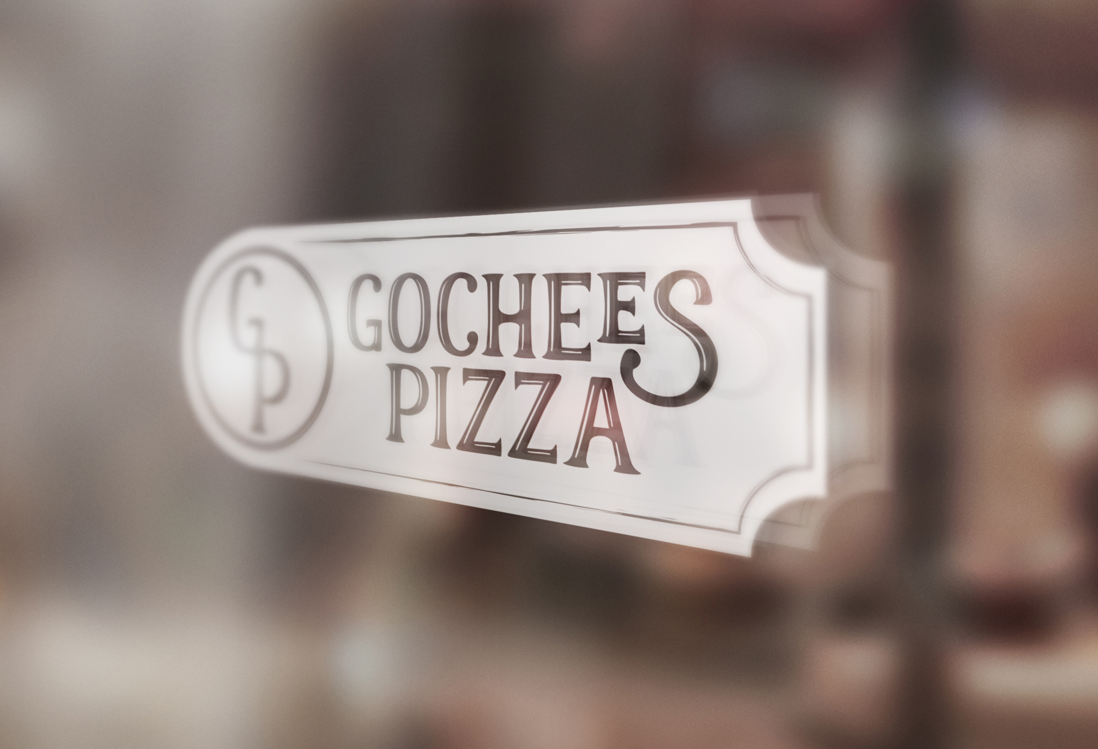 Glass window with Gochees Pizza sign
