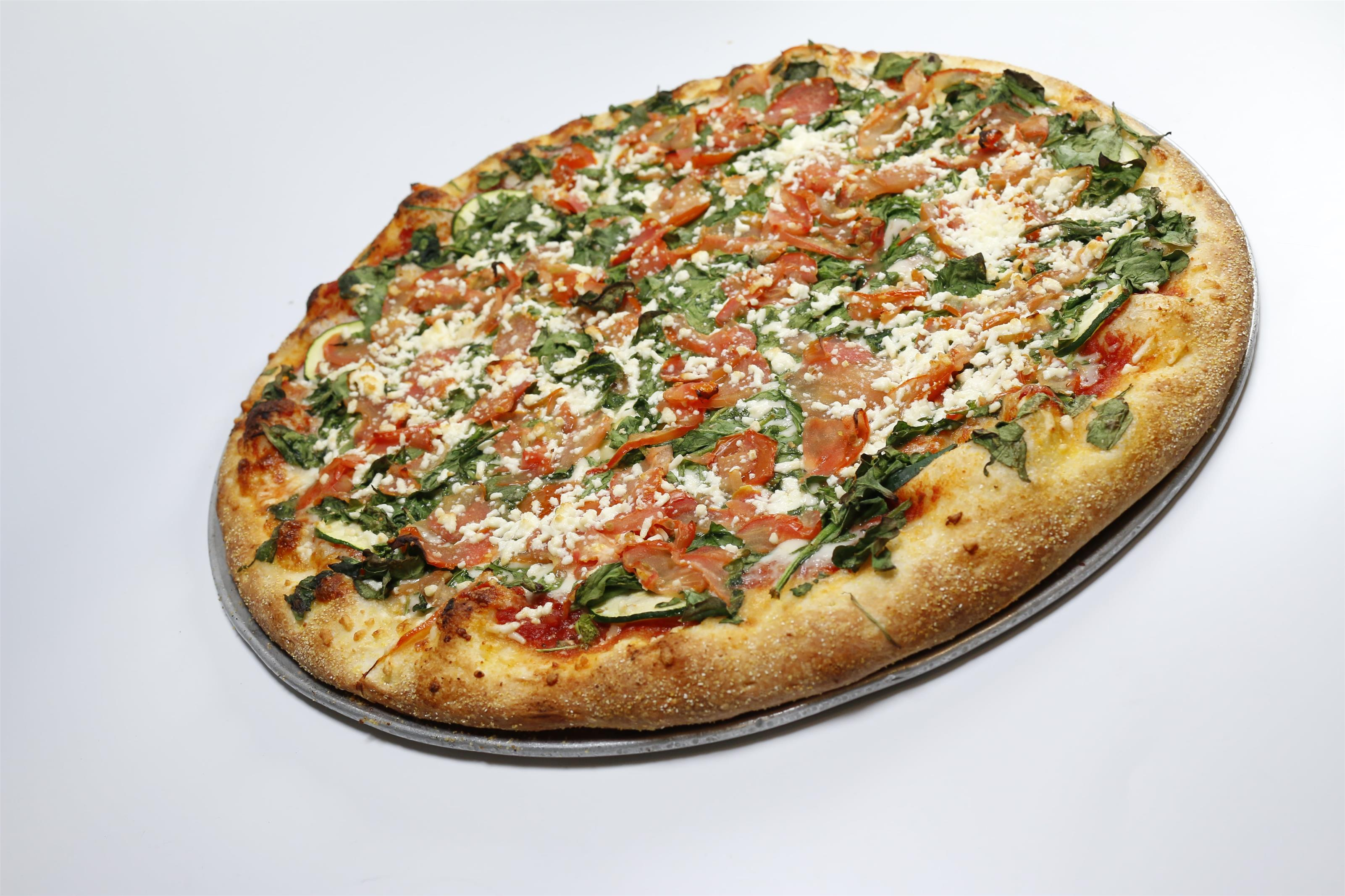 Margharita pizza with tomatos, feta cheese, and shredded basil