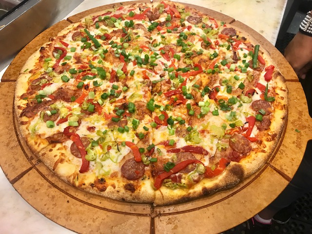 Tomato Sauce, Mozzarella, Calabresa, Bacon, Red Roasted Pepper, Pepperoncini, Green Onions