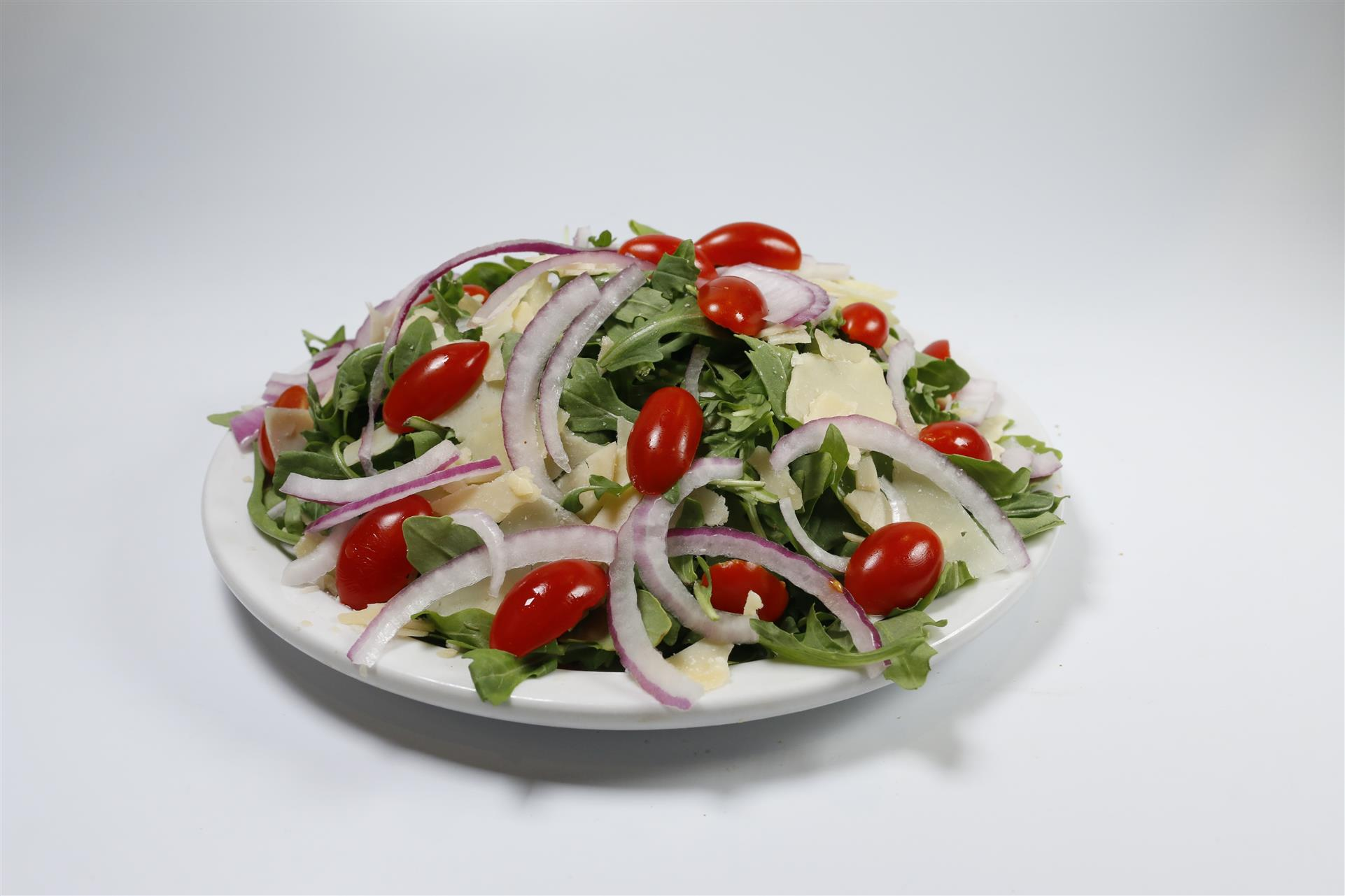 arugula salad with cherry tomatoes, red onion, and parmesan cheese
