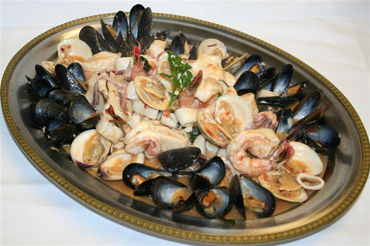 Mussels, clams, shrimp, calamari in large dish