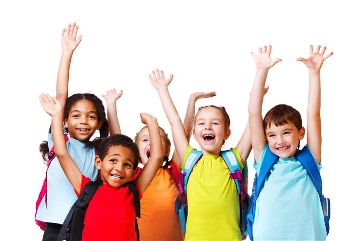 Young children raising hands in the air, smiling.
