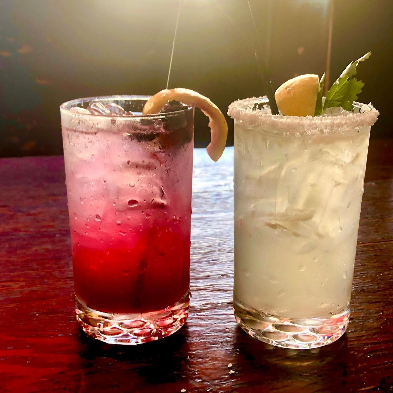 two cocktails on a bar