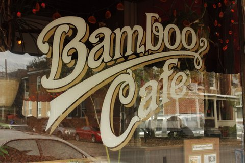 windo art that says bamboo cafe