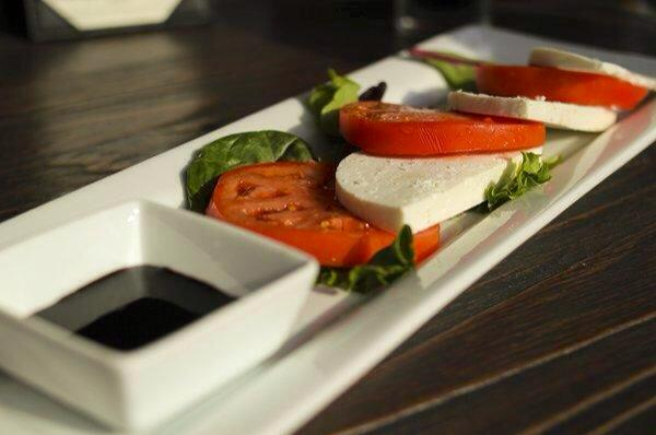 Tomato and mozzarella slices with balsamic.
