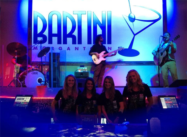 Band on stage in front of bartini sign. Bartini staff members in front of stage.