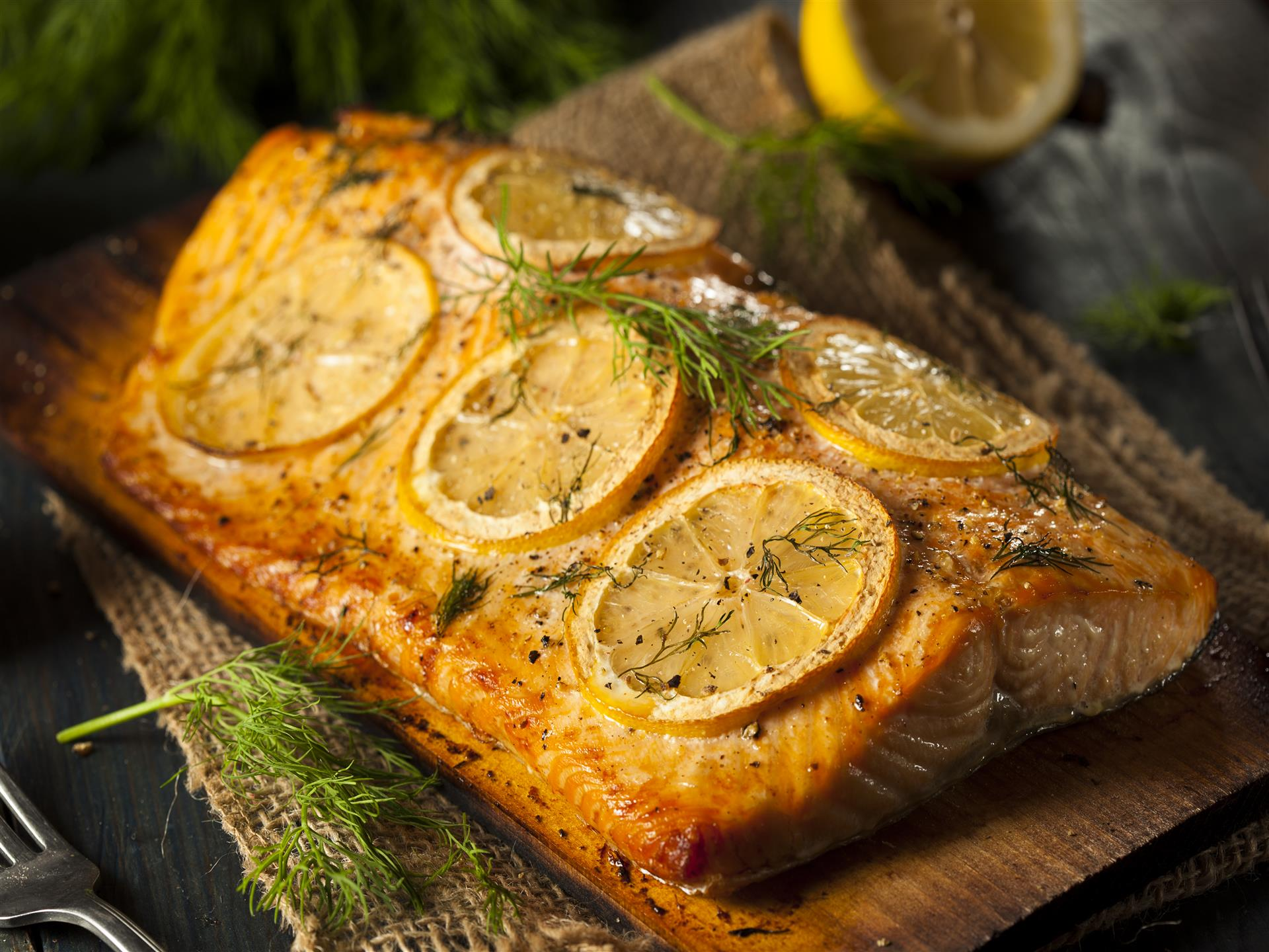 Salmon with lemon on cedar plank.